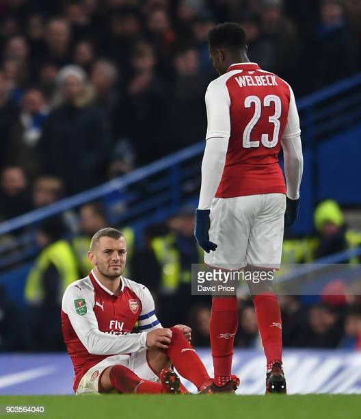 Jack Wilshere of Arsenal on the floor injured as Danny Welbeck checks on him during the Carabao Cup Semie Final 1st leg match between Chelsea and...
