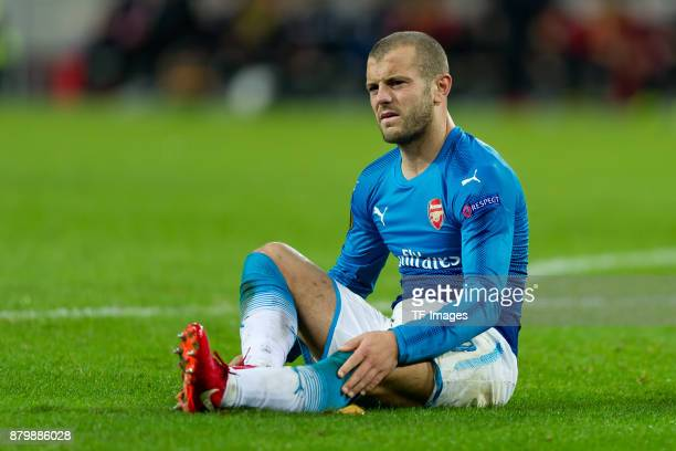 Jack Wilshere of Arsenal on the ground during the UEFA Europa League Group H soccer match between 1FC Cologne and Arsenal FC at the RheinEnergie...