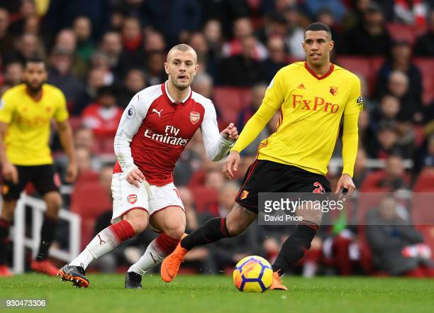 Jack Wilshere of Arsenal passes the ball under pressure from Etienne Capoue of Watford during the Premier League match between Arsenal and Watford at...