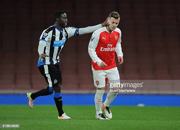 Jack Wilshere of Arsenal pushed in the face by Newcastle's Henri Saivet during the Barclays Premier League match between Arsenal and Newcastle United...