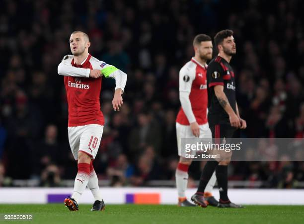 Jack Wilshere of Arsenal puts on the Captains armband after the injury of Laurent Koscielny during the UEFA Europa League Round of 16 Second Leg...