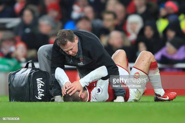 Jack Wilshere of Arsenal reacts after taking a blow to the head during the Premier League match between Arsenal and Crystal Palace at Emirates...