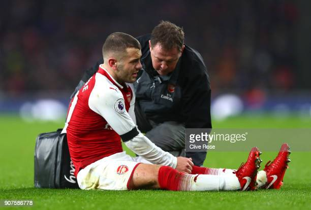 Jack Wilshere of Arsenal reacts as he receives treatment from the medical team during the Premier League match between Arsenal and Crystal Palace at...