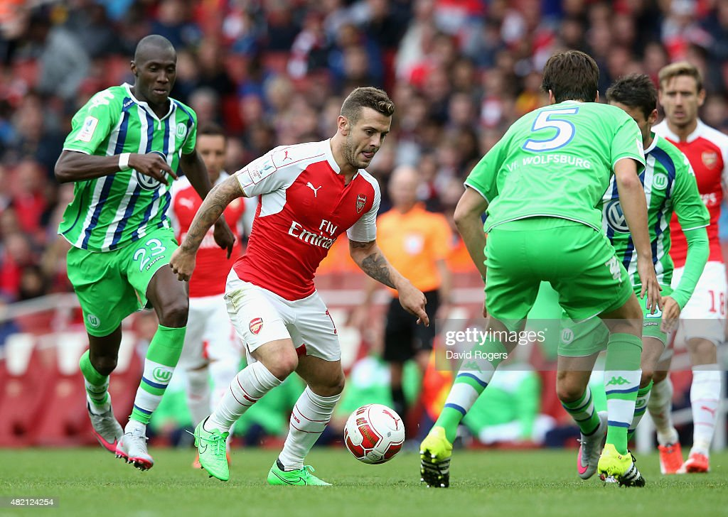 Jack Wilshere of Arsenal runs with the ball during the Emirates Cup match between Arsenal and VfL Wolfsburg at the Emirates Stadium on July 26, 2015 in London, England.