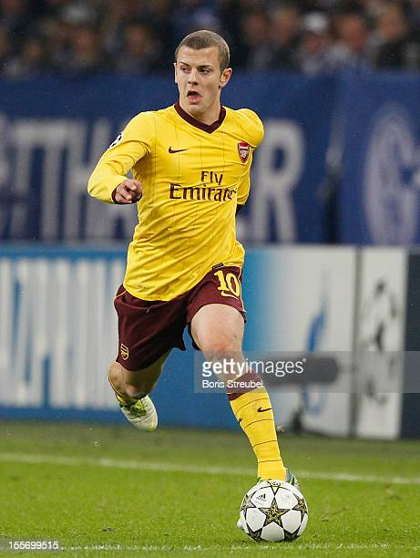 Jack Wilshere of Arsenal runs with the ball during the UEFA Champions League group B match between FC Schalke 04 and Arsenal FC at VeltinsArena on...