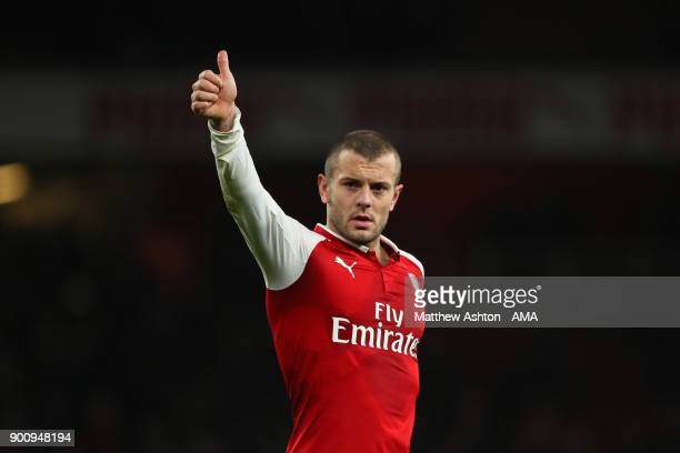 Jack Wilshere of Arsenal salutes the fans at the end of the Premier League match between Arsenal and Chelsea at Emirates Stadium on January 3 2018 in...