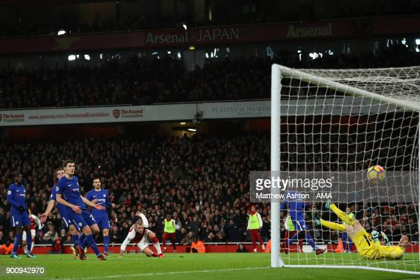 Jack Wilshere of Arsenal scores a goal to make the score 10 during the Premier League match between Arsenal and Chelsea at Emirates Stadium on...