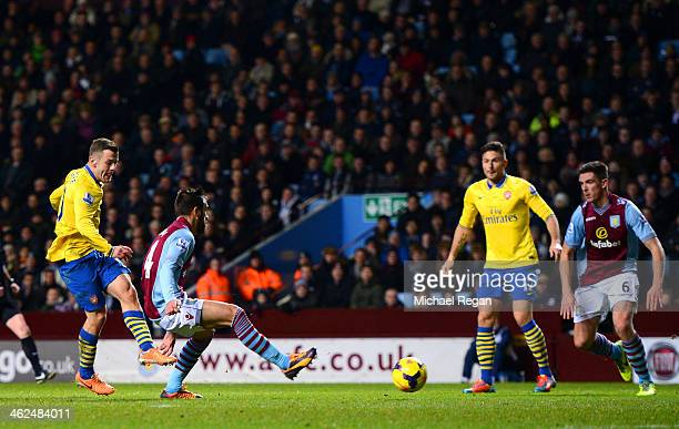 Jack Wilshere of Arsenal scores the opening goal during the Barclays Premier League match between Aston Villa and Arsenal at Villa Park on January 13...