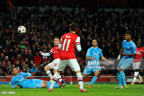 Jack Wilshere of Arsenal scores their firs goal during the UEFA Champions League Group F match between Arsenal and Olympique de Marseille at Emirates...