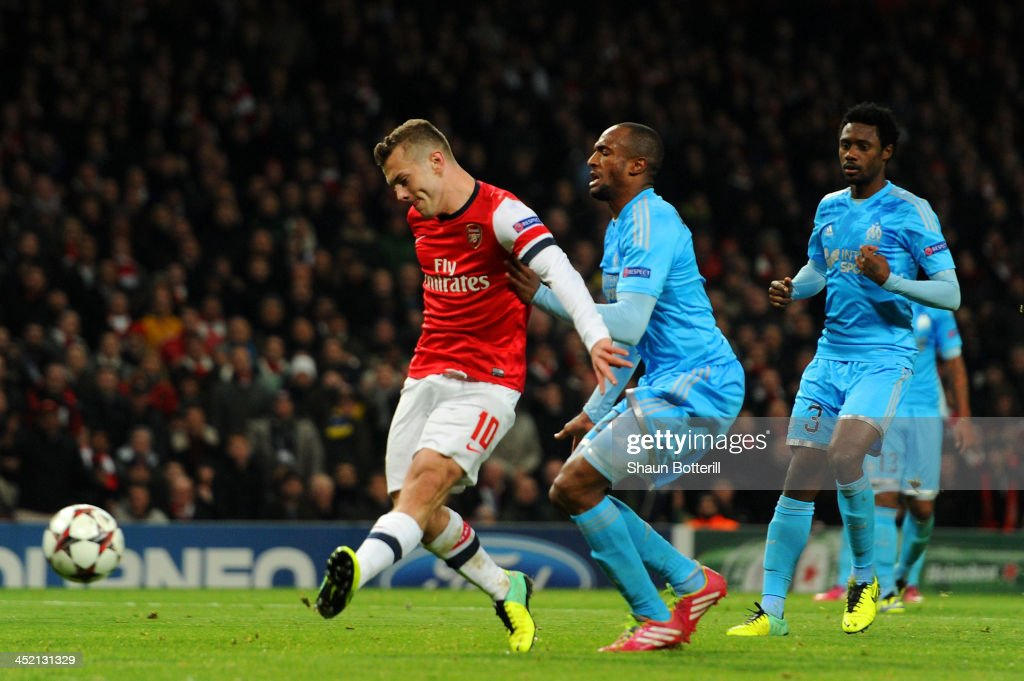 Jack Wilshere of Arsenal scores their second goal during the UEFA Champions League Group F match between Arsenal and Olympique de Marseille at Emirates Stadium on November 26, 2013 in London, England.