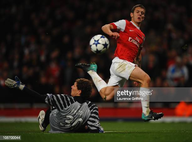 Jack Wilshere of Arsenal shoots past Andriy Pyatov of Shakhtar Donetsk to score their fourth goal during the UEFA Champions League Group H match...
