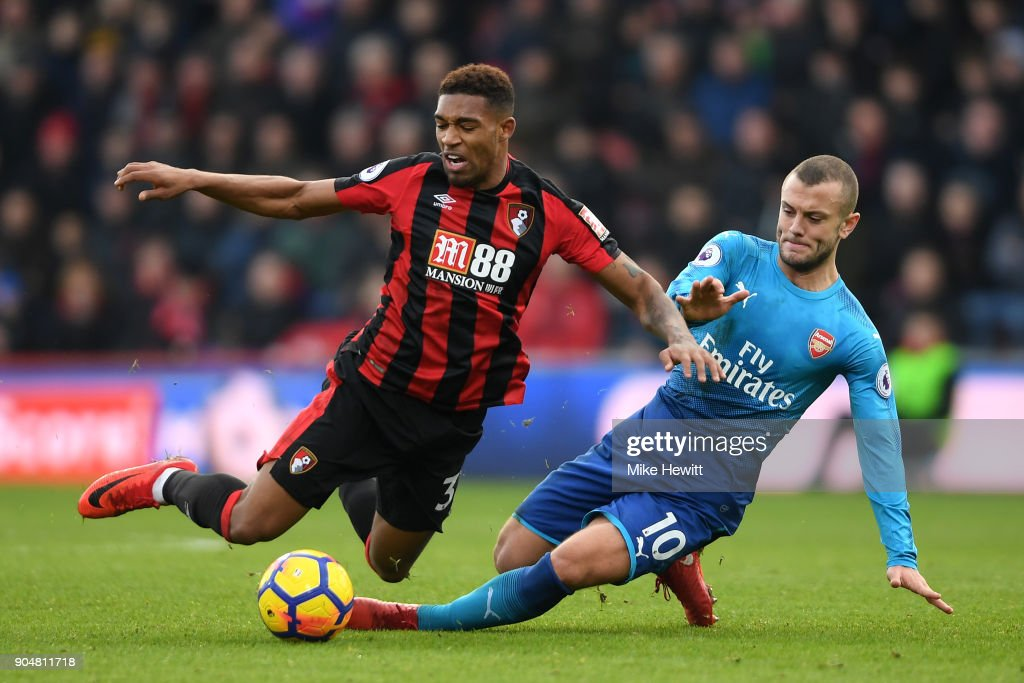 Jack Wilshere of Arsenal tackles Jordon Ibe of AFC Bournemouth during the Premier League match between AFC Bournemouth and Arsenal at Vitality Stadium on January 14, 2018 in Bournemouth, England.