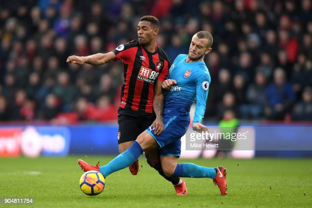 Jack Wilshere of Arsenal tackles Jordon Ibe of AFC Bournemouth during the Premier League match between AFC Bournemouth and Arsenal at Vitality...