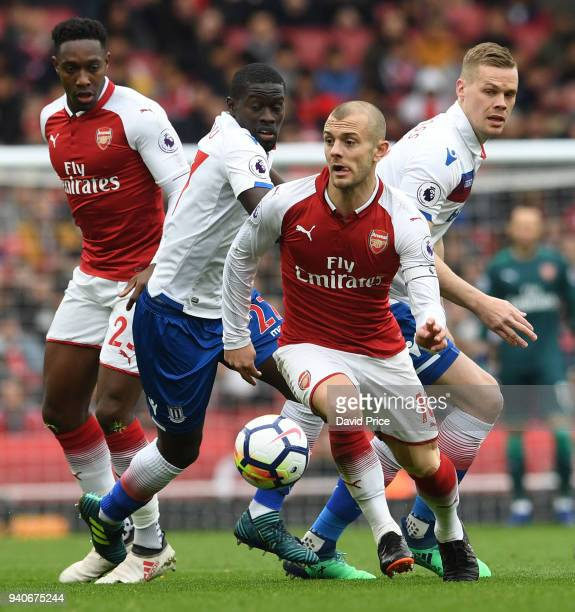 Jack Wilshere of Arsenal takes on Badou Ndiaye and Ryan Shawcross fo Stoke during the Premier League match between Arsenal and Stoke City at Emirates...