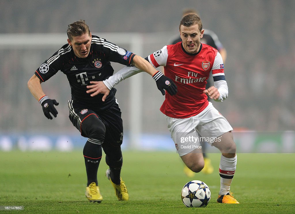 Jack Wilshere of Arsenal takes on Bastian Schweinsteiger of Bayern during the UEFA Champions League Round of 16 first leg match between Arsenal FC and Bayern Muenchen at Emirates Stadium on February 19, 2013 in London, England.