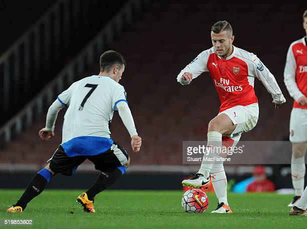 Jack Wilshere of Arsenal takes on Callum Roberts of Newcastle during the Barclays Premier League match between Arsenal and Newcastle United at...
