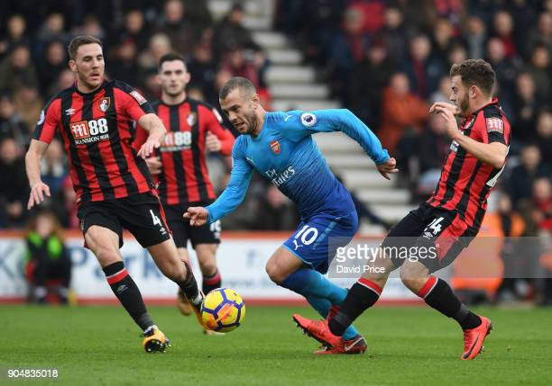 Jack Wilshere of Arsenal takes on Dan Gosling and Ryan Fraser of Bournemouth during the Premier League match between AFC Bournemouth and Arsenal at...