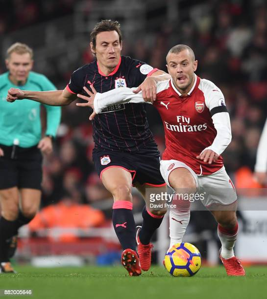 Jack Wilshere of Arsenal takes on Dean Whitehead of Huddersfield during the Premier League match between Arsenal and Huddersfield Town at Emirates...