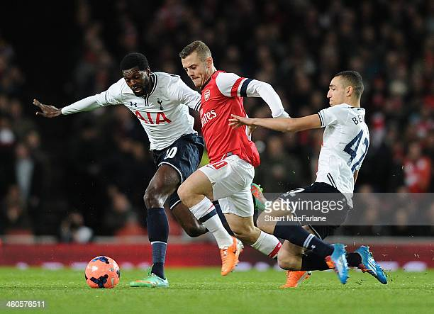 Jack Wilshere of Arsenal takes on Emmanuel Adebayor and Nabil Bentaleb of Tottenham during the Budweiser FA Cup third round match between Arsenal and...