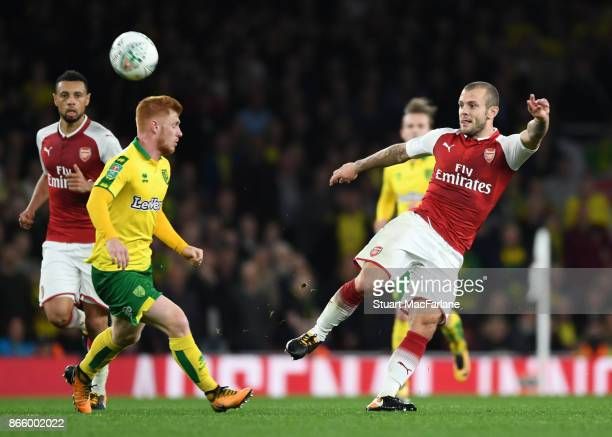 Jack Wilshere of Arsenal takes on Harrison Reed of Norwich during the Carabao Cup Fourth Round match between Arsenal and Norwich City at Emirates...