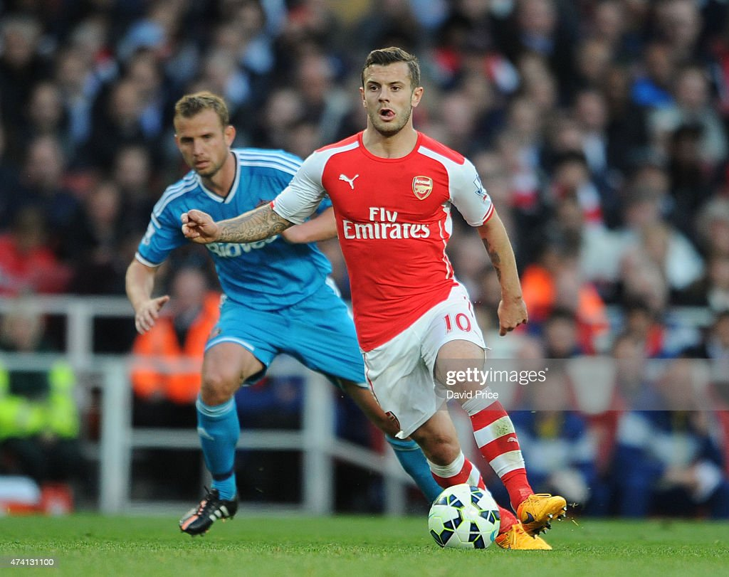 Jack Wilshere of Arsenal takes on Lee Cattermole of Sunderland during the match between Arsenal and Sunderland in the Barclays Premier League at Emirates Stadium on May 20, 2015 in London, England.