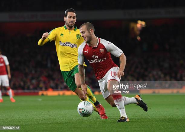 Jack Wilshere of Arsenal takes on Mario Vrancic of Norwich during the Carabao Cup Fourth Round match between Arsenal and Norwich City at Emirates...