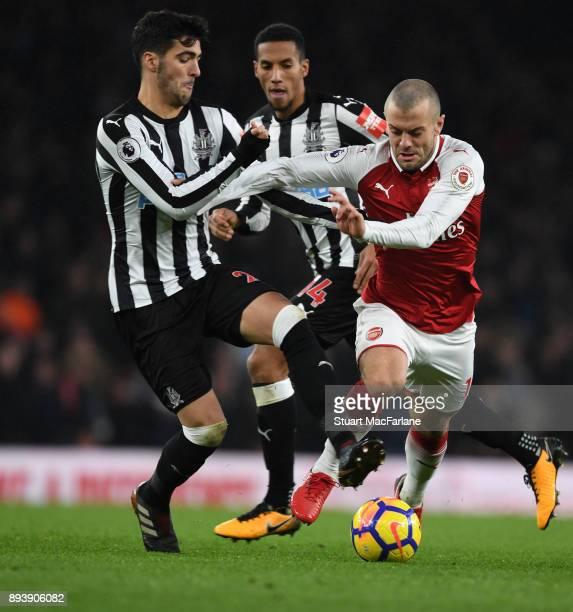 Jack Wilshere of Arsenal takes on Mikel Merino of Newcaslte during the Premier League match between Arsenal and Newcastle United at Emirates Stadium...