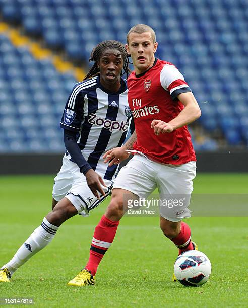 Jack Wilshere of Arsenal takes on Romaine Sawyers of West Brom during the Barclays Under21 League match between West Bromwich Albion U21 and Arsenal...