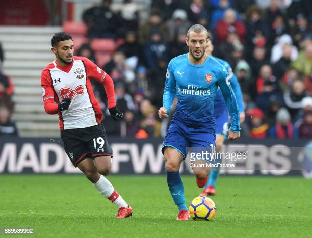 Jack Wilshere of Arsenal takes on Sofiane Boufal of Southampton during the Premier League match between Southampton and Arsenal at St Mary's Stadium...
