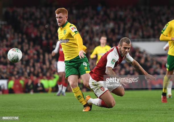 Jack Wilshere of Arsenal tis fouled by Harrison Reed of Norwich during the Carabao Cup Fourth Round match between Arsenal and Norwich City at...