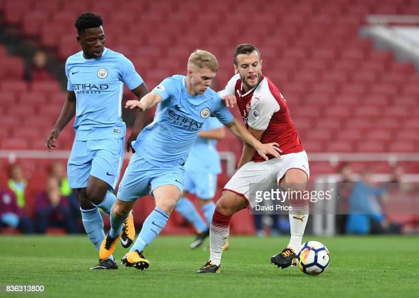 Jack Wilshere of Arsenal under pressure from Jacob Davenport and Tomiwa DeleBashiru of Manchester City during the match between Arsenal U23 and...