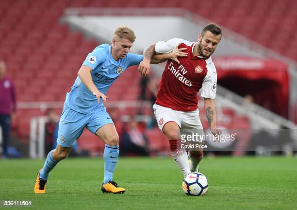 Jack Wilshere of Arsenal under pressure from Jacob Davenport of Manchester City during the match between Arsenal U23 and Manchester City U23 at...