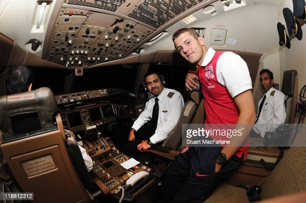 Jack Wilshere of Arsenal visits the cockpit on the flight to Malaysia for the club's preseason Asian tour on July 10 2011