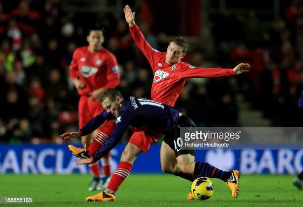 Jack Wilshere of ArsenalJack Wilshere of Arsenal is tackled by Steven Davis of Southampton during the Barclays Premier league match between...