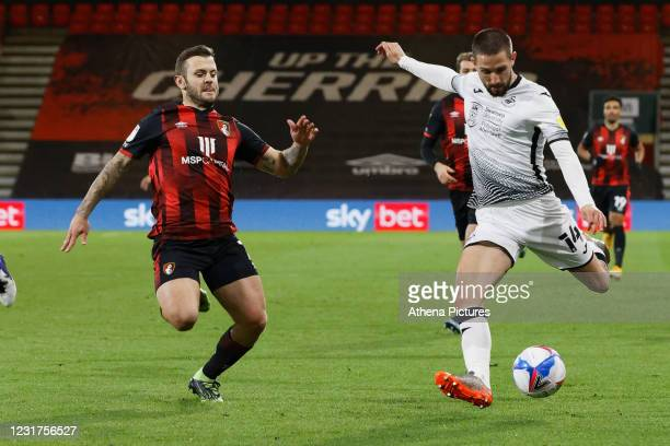 Jack Wilshere of Bournemouth and Conor Hourihane of Swansea City in action during the Sky Bet Championship match between Bournemouth and Swansea City...