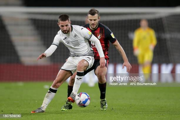Jack Wilshere of Bournemouth closes down Conor Hourihane of Swansea City during the Sky Bet Championship match between AFC Bournemouth and Swansea...