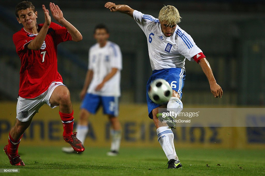 Jack Wilshere of England battles with Vasileios Pliatsikas (R) of Greece during the UEFA U21 Championship match between Greece and England at the Asteras Tripolis Stadium on September 8, 2009 in Tripolis, Greece.