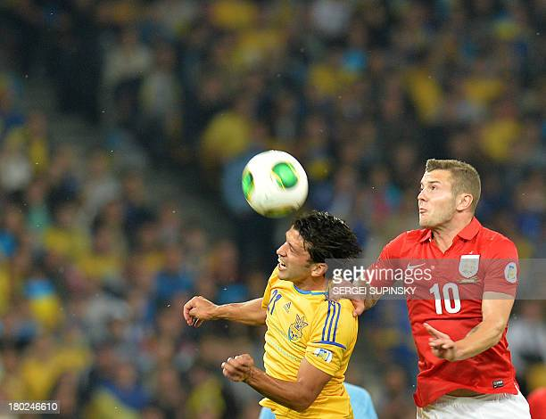 Jack Wilshere of England fights for a ball with Edmar Halovskiy of Ukraine during their Brazil 2014 FIFA World Cup qualifiers Group H football match...