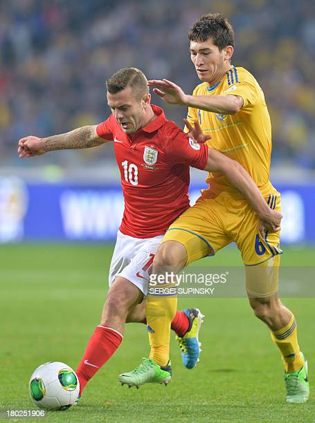 Jack Wilshere of England fights for a ball with Taras Stepanenko of Ukraine during their Brazil 2014 FIFA World Cup qualifiers Group H football match...