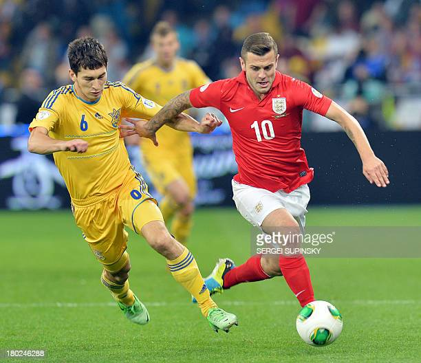 Jack Wilshere of England fights for the ball with Taras Stepanenko of Ukraine during their Brazil 2014 FIFA World Cup qualifiers Group H football...