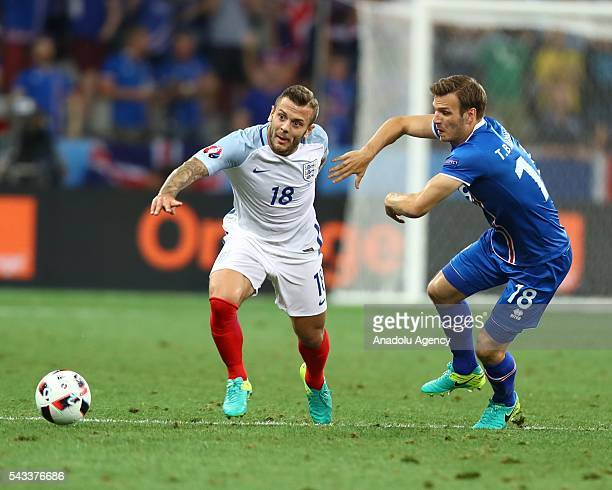 Jack Wilshere of England in action against Elmar Bjarnason of Iceland during the UEFA Euro 2016 Round of 16 football match between Iceland and...