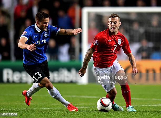 Jack Wilshere of England is pursued by Martin Vunk of Estonia during the EURO 2016 Qualifier match between Estonia and England at A Le Coq Arena on...