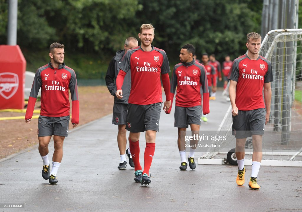 Jack Wilshere, Per Mertesacker and Rob Holding of Arsenal before a training session at London Colney on September 8, 2017 in St Albans, England.