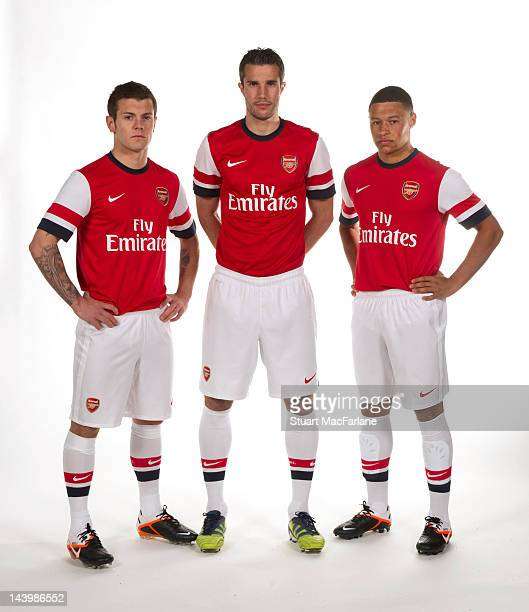 Jack Wilshere Robin van Persie and Alex OxladeChamberlain pose during a photoshoot for the new Arsenal home kit for season 2012/13 at London Colney...