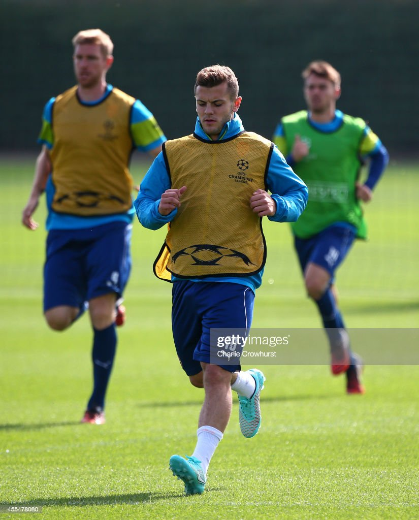 Jack Wilshere warms up during a Arsenal Training Session ahead of their Champions League fixture against Borussia Dortmund on September 15, 2014 in St Albans, England.