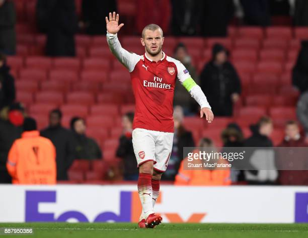 Jack Wilshere waves to the Arsenal fans after the UEFA Europa League group H match between Arsenal FC and BATE Borisov at Emirates Stadium on...