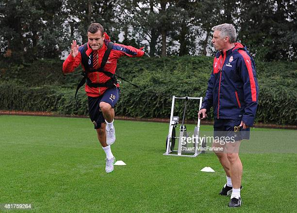 Jack Wilshere with fitness coach Craig Gant during a training session at London Colney on July 24, 2015 in St Albans, England.
