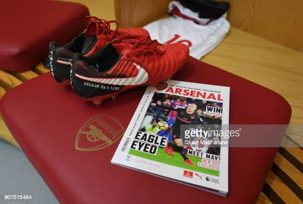 Jack Wilshere's boots and the matchday programme in the Arsenal changing room before the Premier League match between Arsenal and Crystal Palace at...