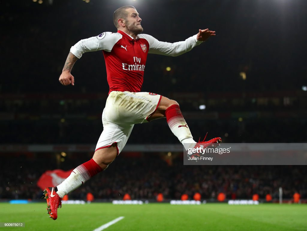 Jack Wilshire of Arsenal celebrates scoring his teams first goal during the Premier League match between Arsenal and Chelsea at Emirates Stadium on January 3, 2018 in London, England.