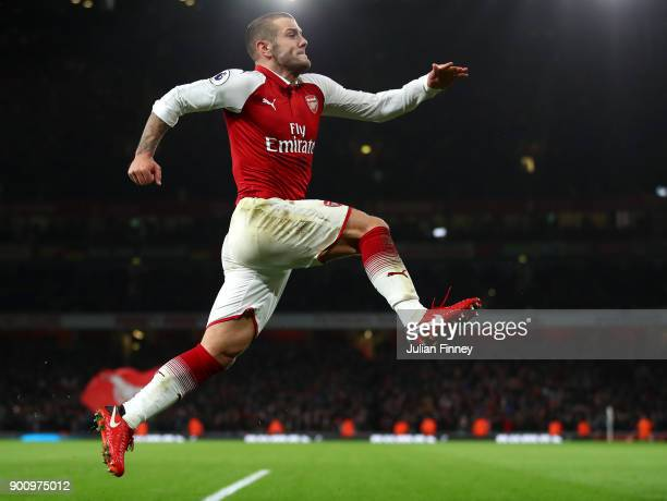 Jack Wilshire of Arsenal celebrates scoring his teams first goal during the Premier League match between Arsenal and Chelsea at Emirates Stadium on...